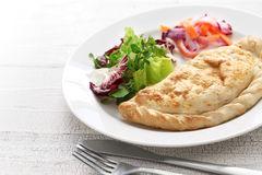 calzone-pizza-italian-food-folded-stuffed-82940755
