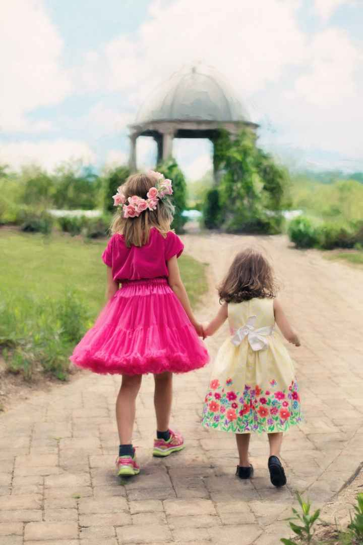 children wearing pink ball dress